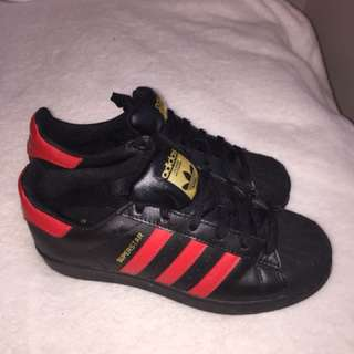 Black and red adidas superstar