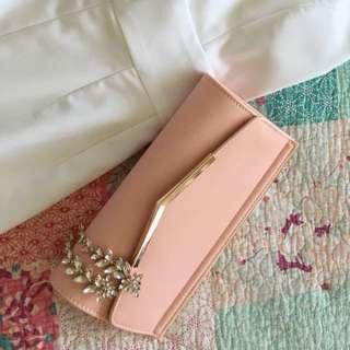 pink collete clutch