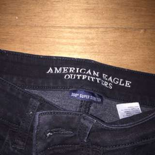 Black American eagle jeans ripped at the knees