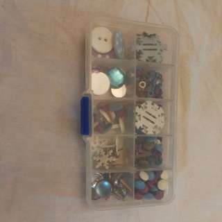 Box of Xmas themes charms buttons, snowflakes, etc