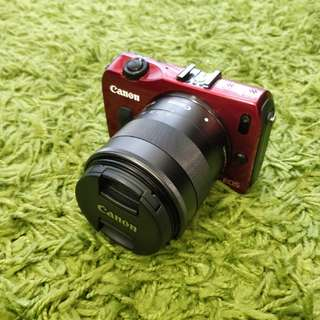 Canon EOS M with 18-55 lens, 2 batteries
