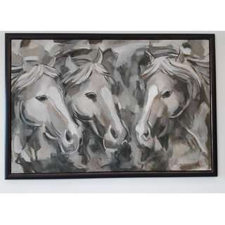Framed painting of horses