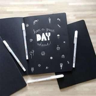 Black paper plain notebook