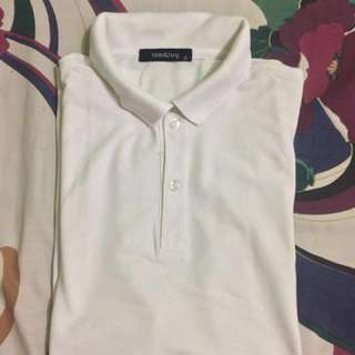 Folded and hung white polo shirt size Small