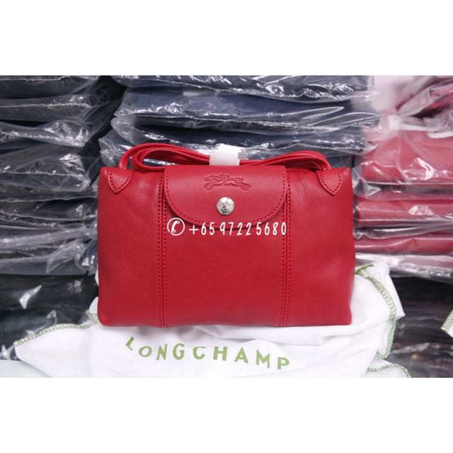 bec3af267 Longchamp Le Pliage Cuir Crossbody Cherry Red 1061 737 045 on Carousell
