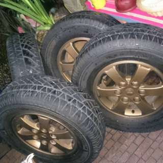 "For SALE 16"" OEM Rim 6 Holes / 245/70 Michelin Cross Latitude Tires"