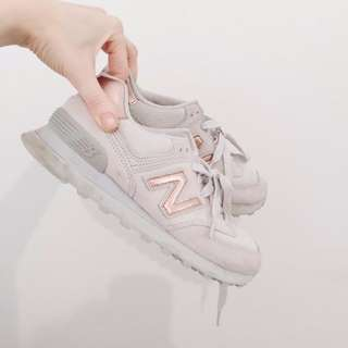 New Balance Classic 574 in light grey and rose gold with glitter flecks.