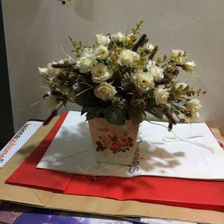 Small flower display in country vase