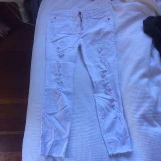 White ripped denim jeans