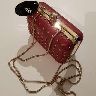 Brand new dotti red purse sling clutch
