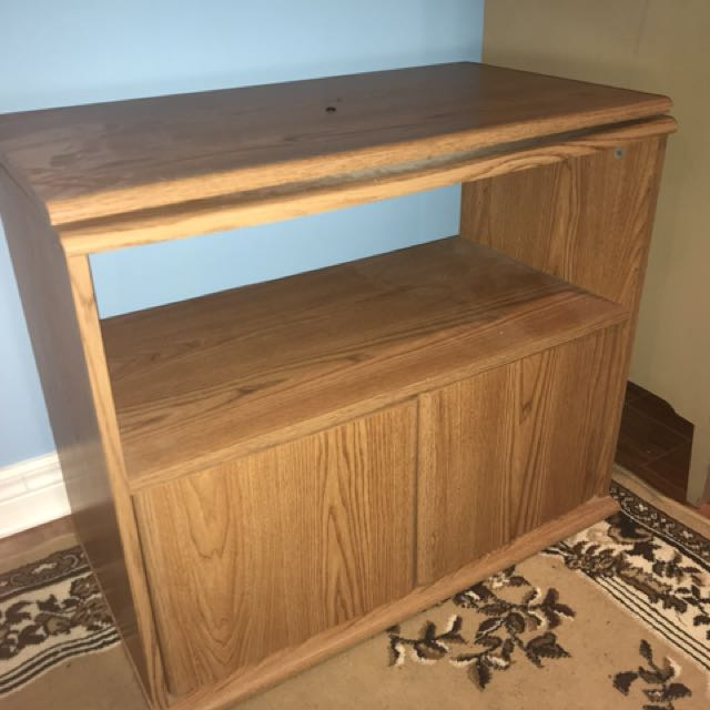 Brown wooden 2-layered side table with closet doors