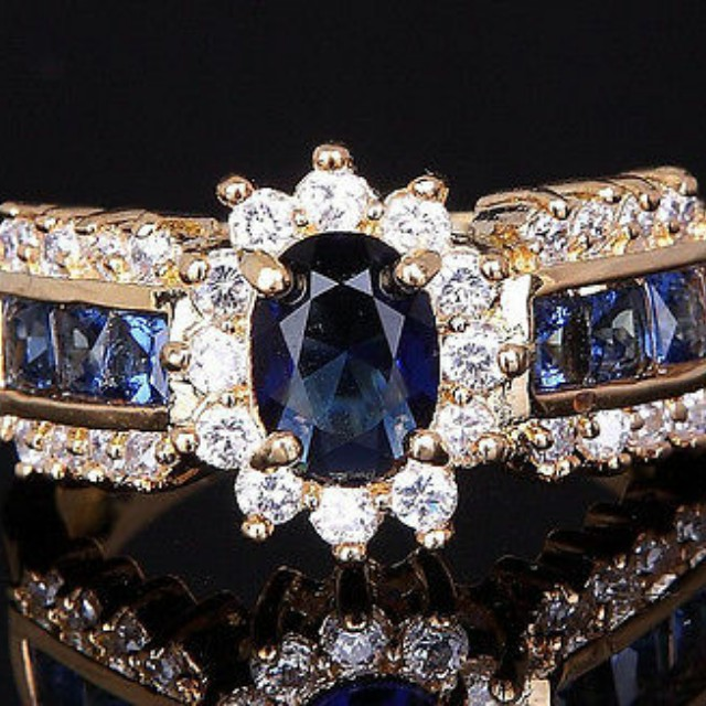Ladies Size 7 Beautiful Cocktail Ring in Yellow Gold Filled Setting with Deep Blue Sapphires and CZ's surrounding NEW