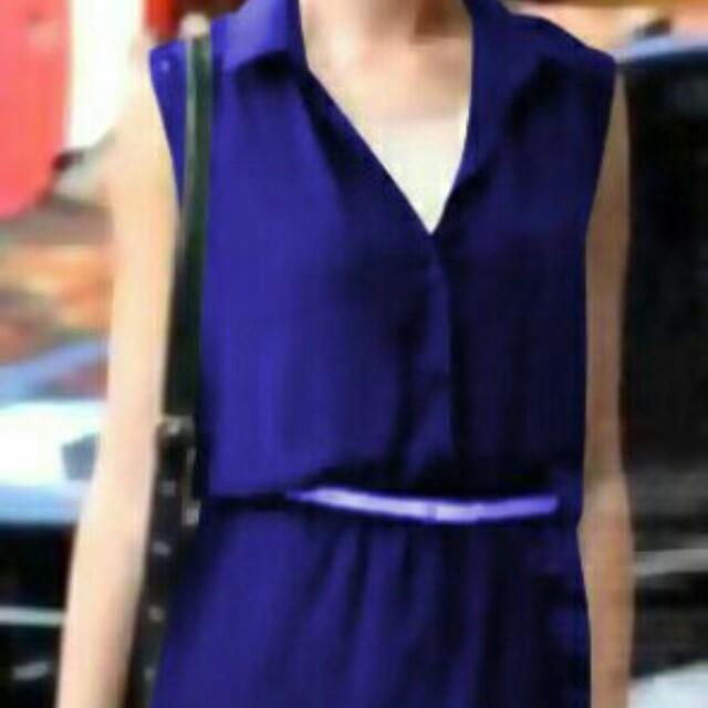 sleeveless blue dress with belt