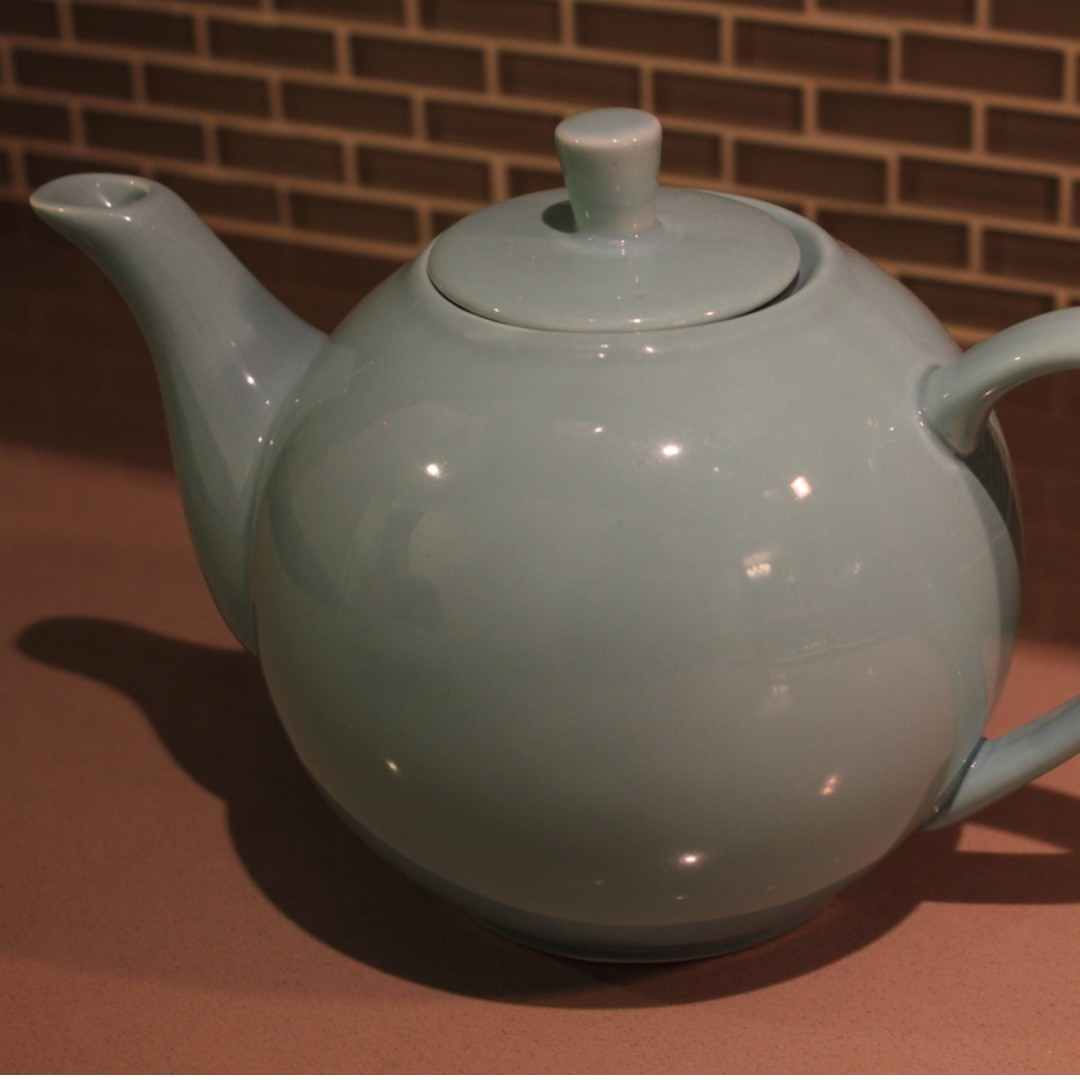 Teapot with tea steeper basket, robin's egg blue