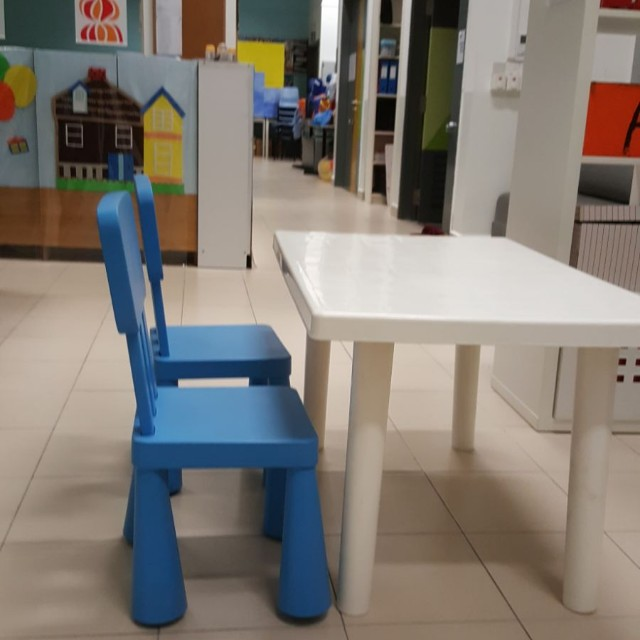 White Plastic Tables Ikea Chairs And Yellow And Blue Chairs