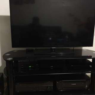 Yamaha Home Theatre 5.1, samsung 46 inch smart TV, glass TV rack and apple tv 3rd gen, HD AV receiver