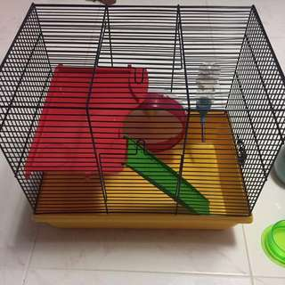 used hamster cage with free accesories (2 hideout,2 food tray,drinking bottle,hamster ball,hamster wheel)