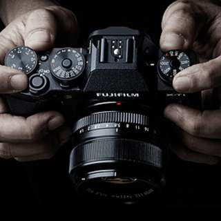 Fujifilm X-T1 with lens and battery grip