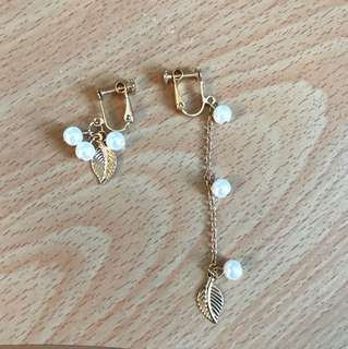 Asymmetrical clip on earrings