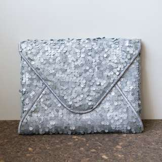 Silver sequined envelope clutch bag