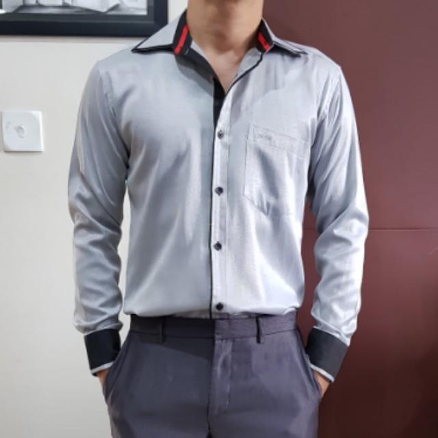 B**s shirt