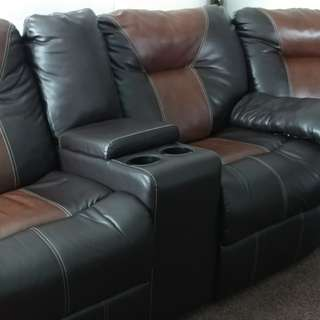 Living room two piece set , also has recliners built in the sofa