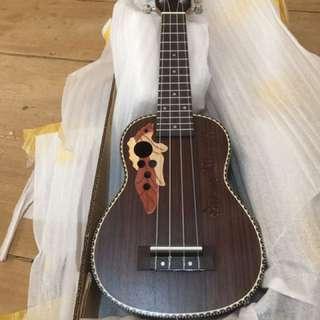 Ukulele guitar with pickup