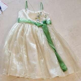 Girl Dress - Pale yellow. Spaghetti straps with green ribbon as belt.