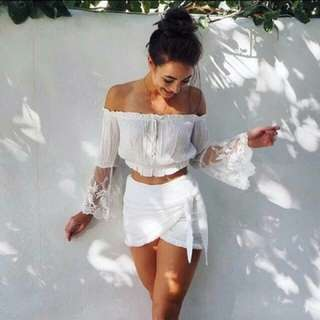 white off shoulder trumpet sleeve top