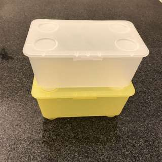 Stackable plastic box with attached lid