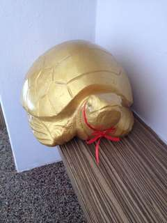 Lucky golden turtle made of jade stone fetch wealth