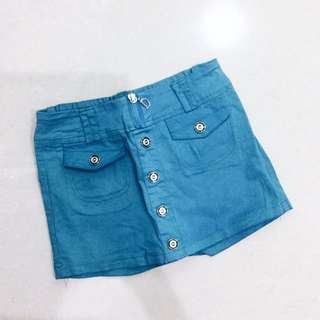 BLUE-GREEN SKIRTS WITH BUTTONS
