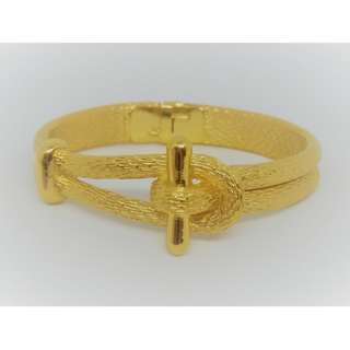 1960s Gold-tone finish Vintage Bangle Bracelet. Signed by Trifari.