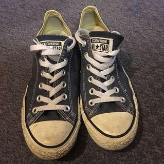Dusty blue coloured low cut converse shoes