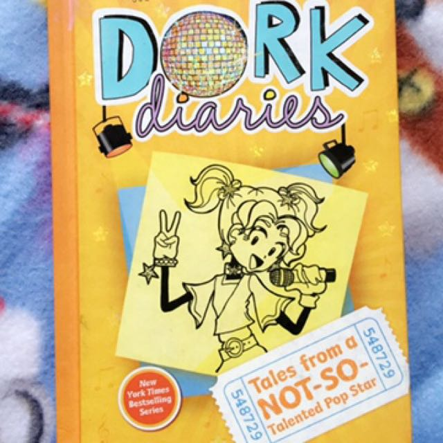 """Dork diaries"",tales from a not-so-talented pop star. Book 3, No writing/2 damaged pages."