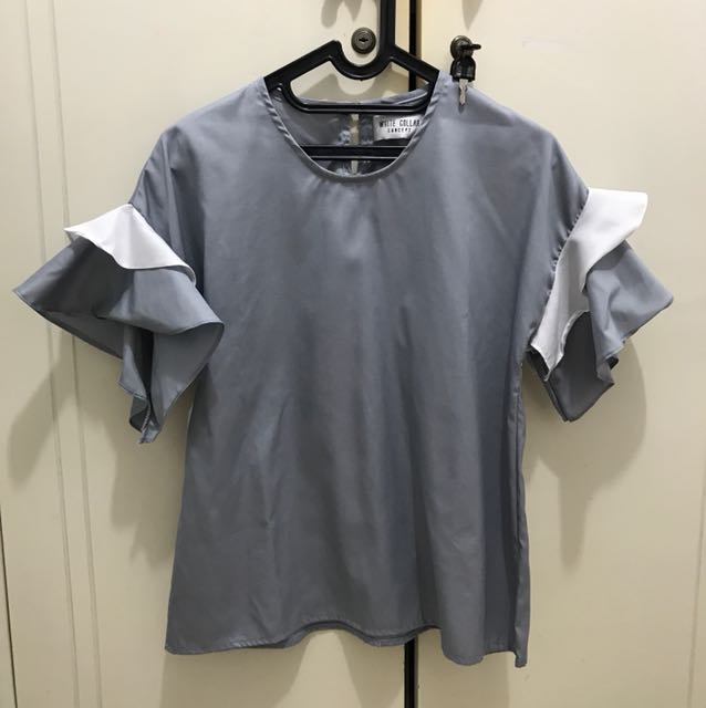 Grey top from white collar concept