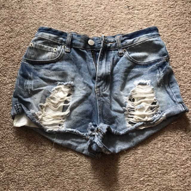 POST INCL - high waist distressed denim shorts
