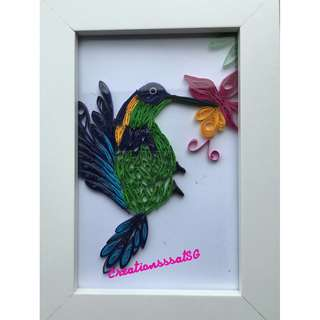 Beautiful quilled design in a photo frame.