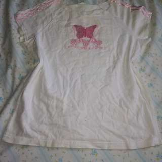 White top with butterfly details