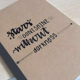 Calligraphed cards and notebooks