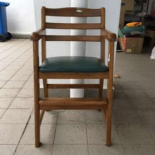 Solid wood antique chair with a foot rest ledge for the child and cushioned too for just $16