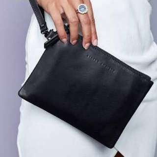 Status anxiety fixation clutch wallet
