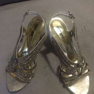 Rusty Lopez gold shoes size 6