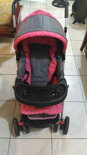 gray and pink stroller