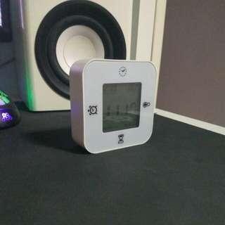 Small white digital clock