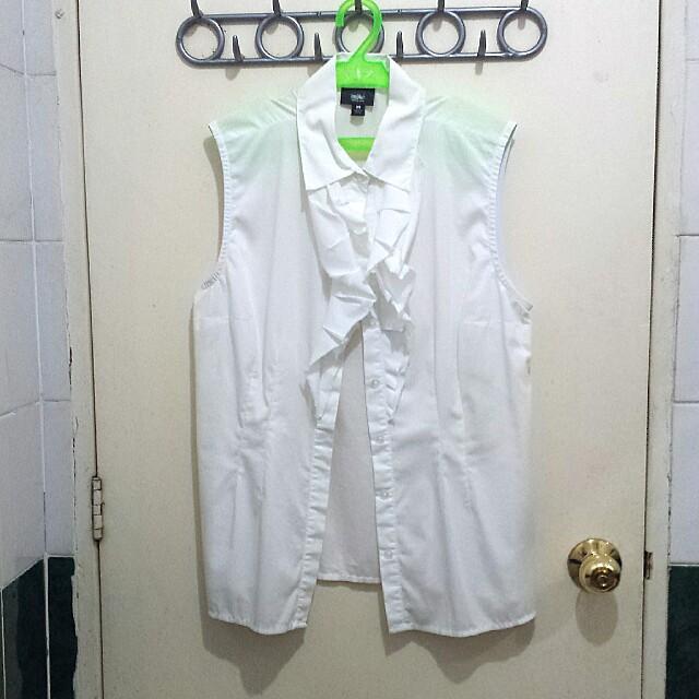 White sleeveless ruffled top