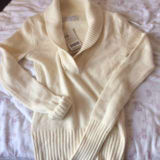 Creamy knitted sweater