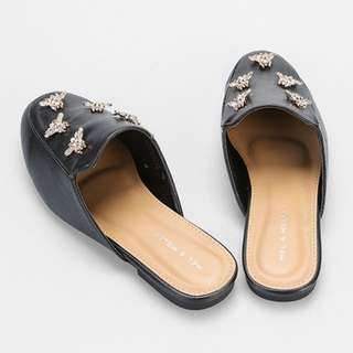 Bee Slip On Flats In Black