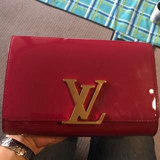 Authentic Louis Vuitton Louise clutch