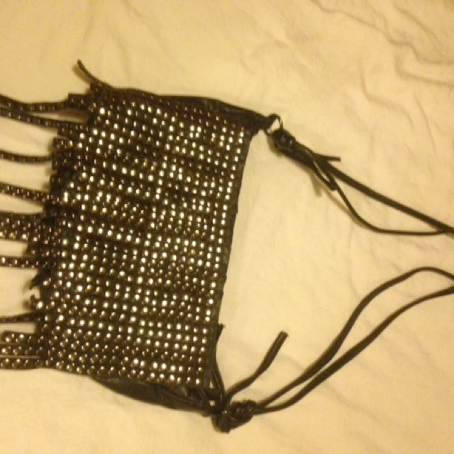 Black leather, fringe, studded bag.